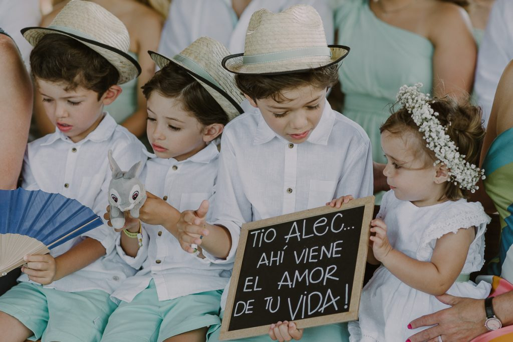 Kids with wedding sign at Jardin del Mar, Riviera Maya Wedding by Caro Navarro Photography