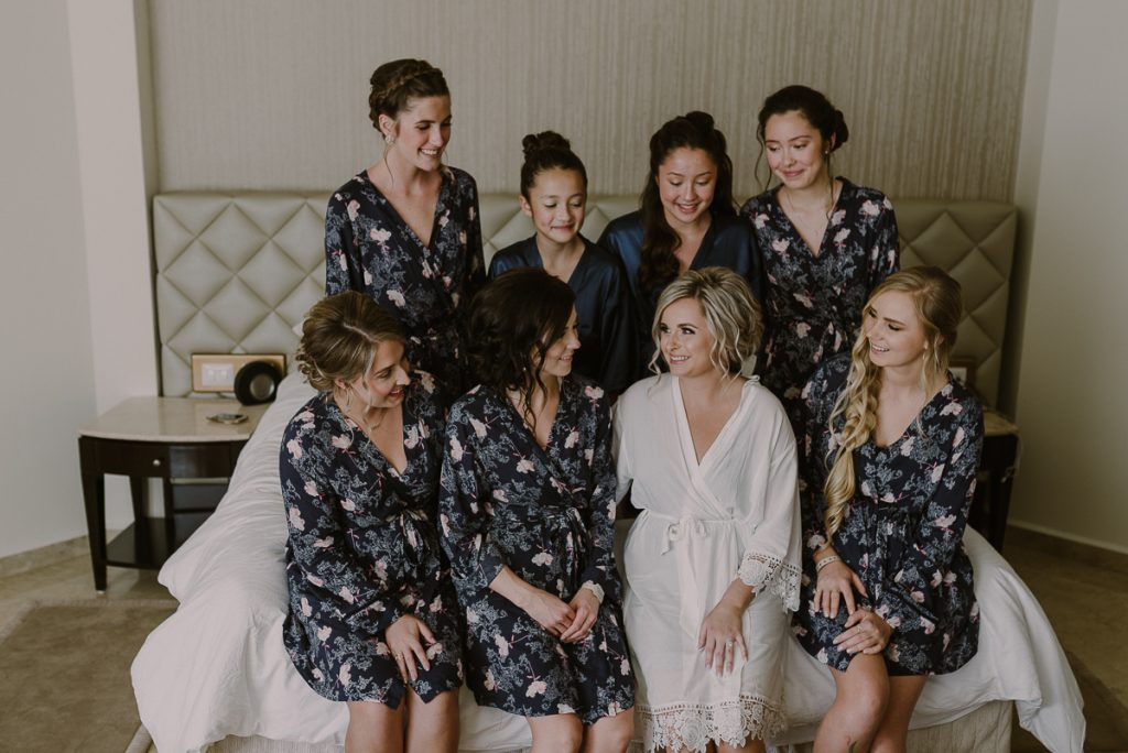 Bridal party in floral robes at Moon Palace Nizuc, Cancun. Caro Navarro Wedding Photography