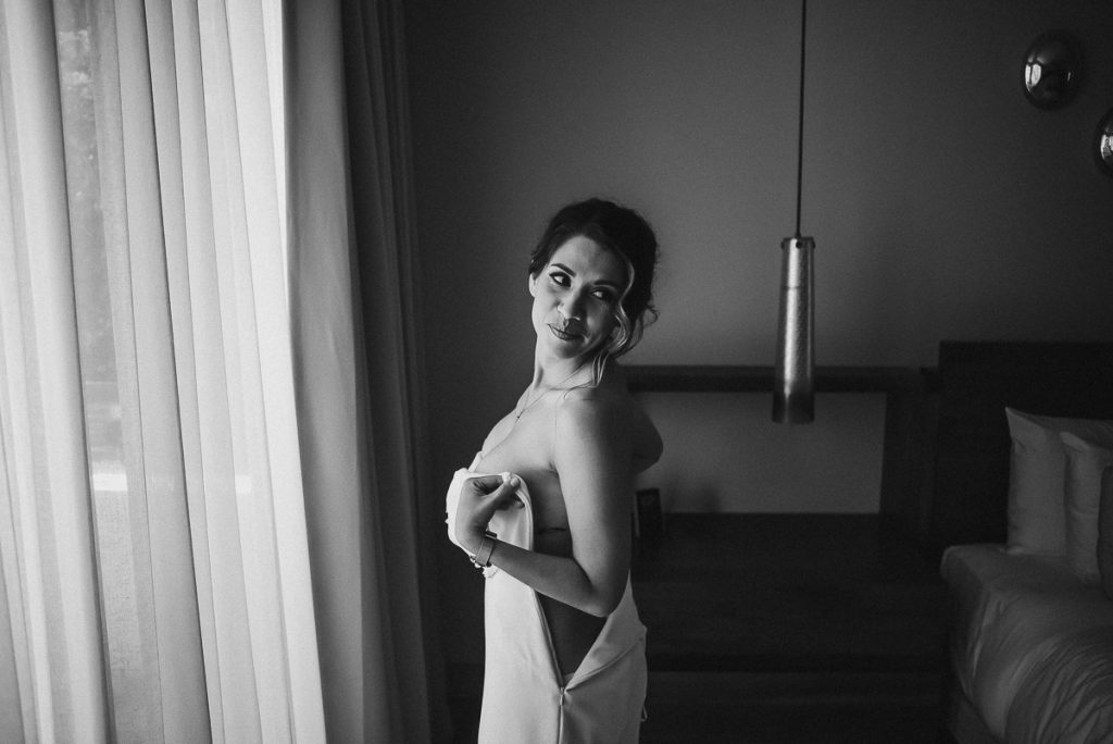 Bride fitting int her wedding dress at Heritage Fairmont Mayakoba by Caro Navarro Photography