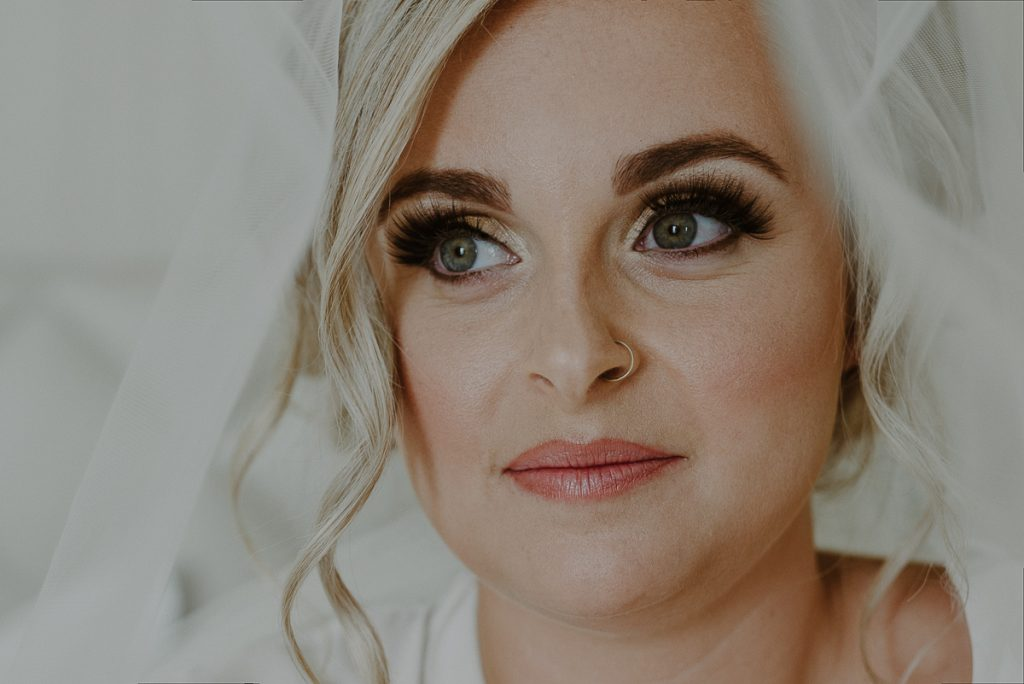 Natural bridal makeup look with lashes at Moon Palace Cancun, Mexico. Caro Navarro Wedding Photography