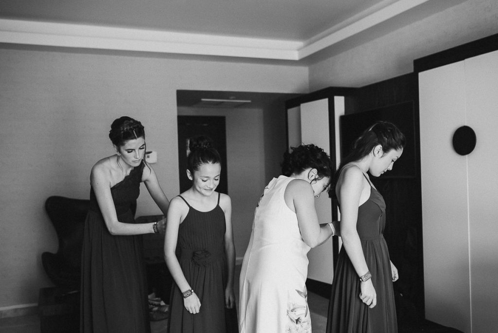 Bridesmaids getting ready for a Moon Palace Nizuc Cancun Wedding by Caro Navarro Photography