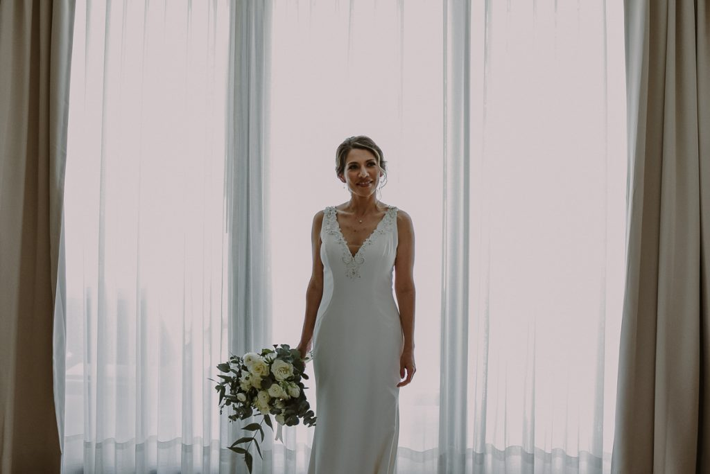 V neck wedding dress at Heritage Fairmont Mayakoba, Mexico. Caro Navarro Photography