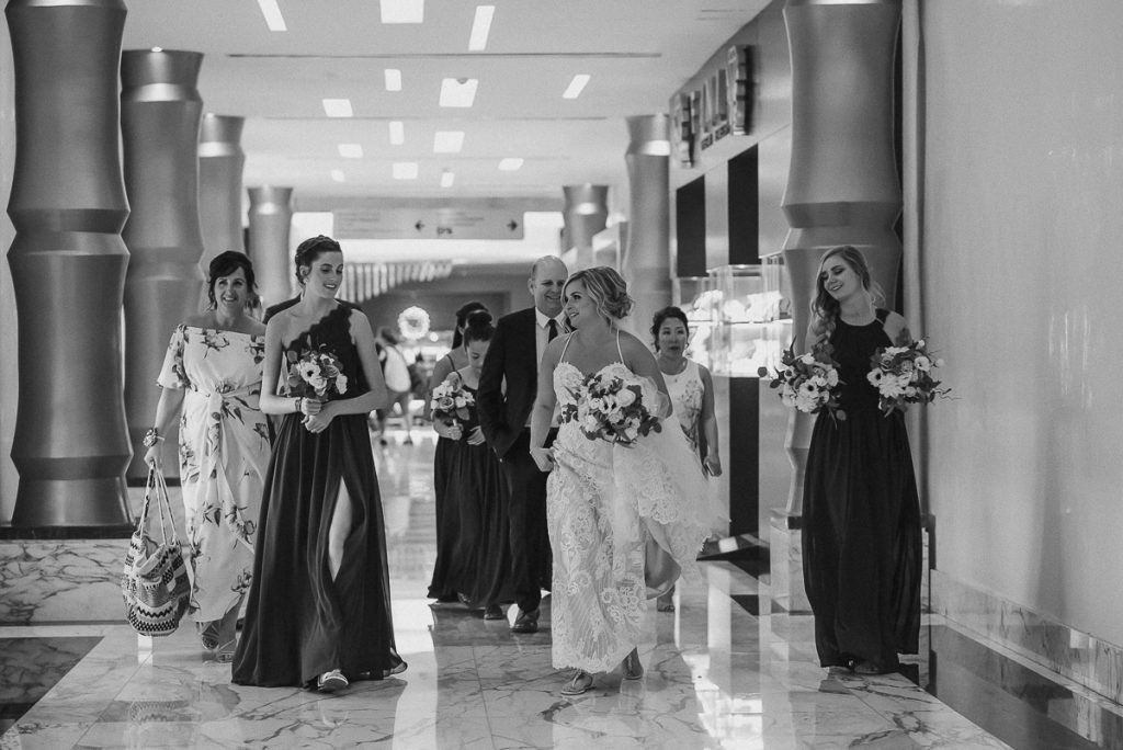 Bride and bridesmaids at Moon Palace Cancun lobby. Caro Navarro Photography