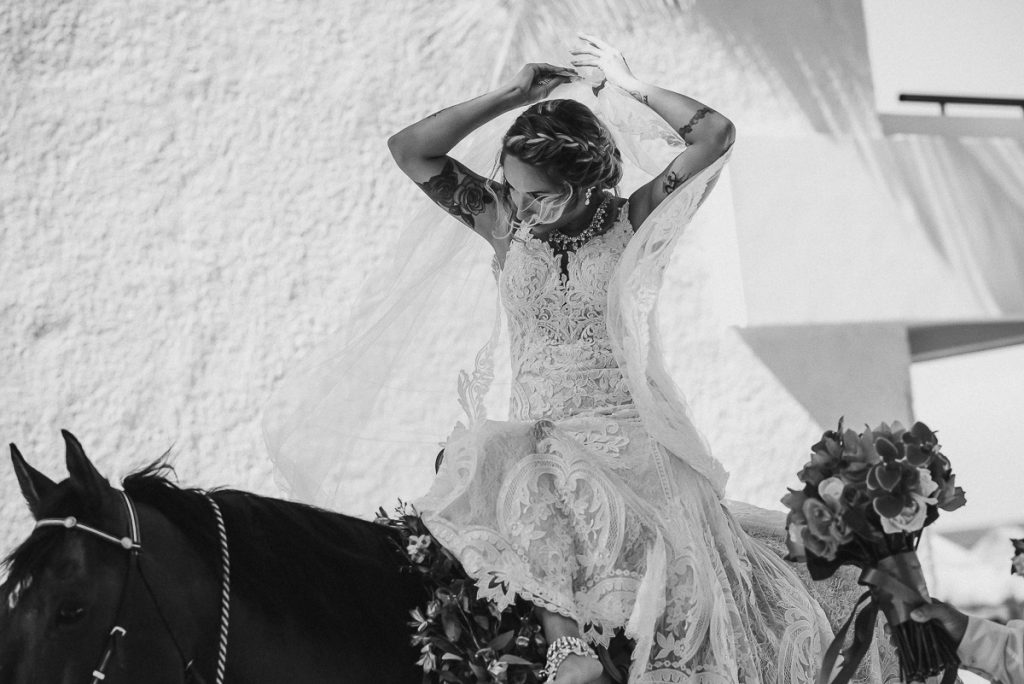 Bride on horse at Now Sapphire Riviera Cancun, Mexico. Caro Navarro Photography