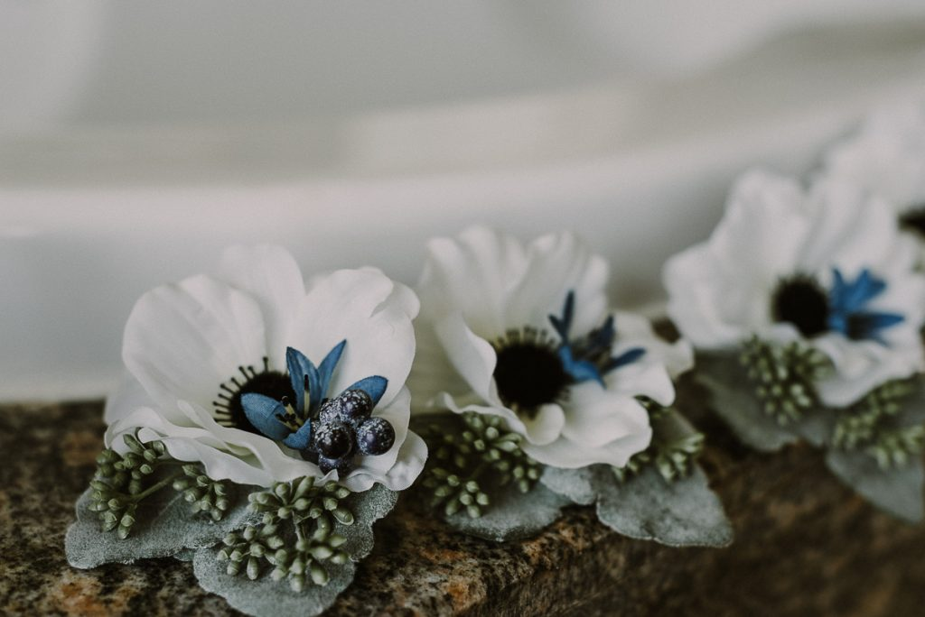Winter wedding boutonnieres by Caro Navarro Photography at Moon Palace Nizuc Cancun