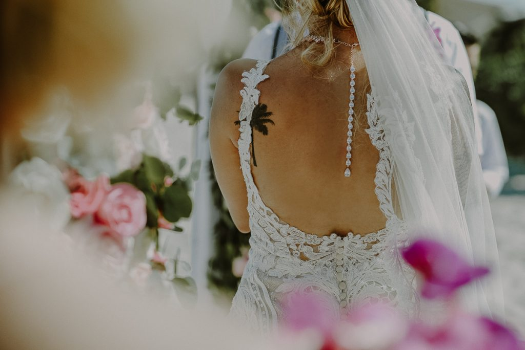 Backless wedding dress detail at Now Sapphire Riviera Cancun Wedding. Caro Navarro Photography