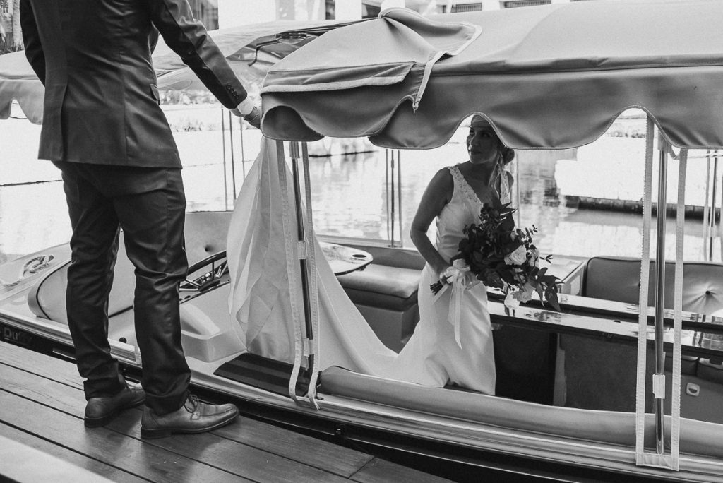 Bride on boat at Banyan Tree Mayakoba, Mexico. Caro Navarro Wedding Photography