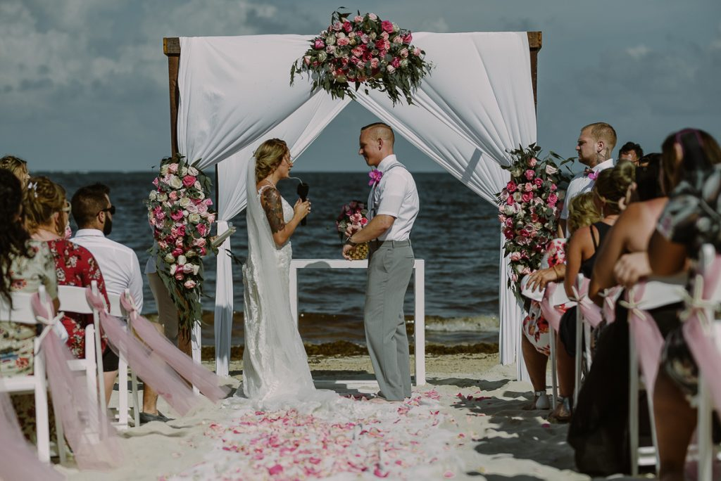 Boho pink and green beach wedding at Now Sapphire Riviera Cancun, Mexico. Caro Navarro Photography