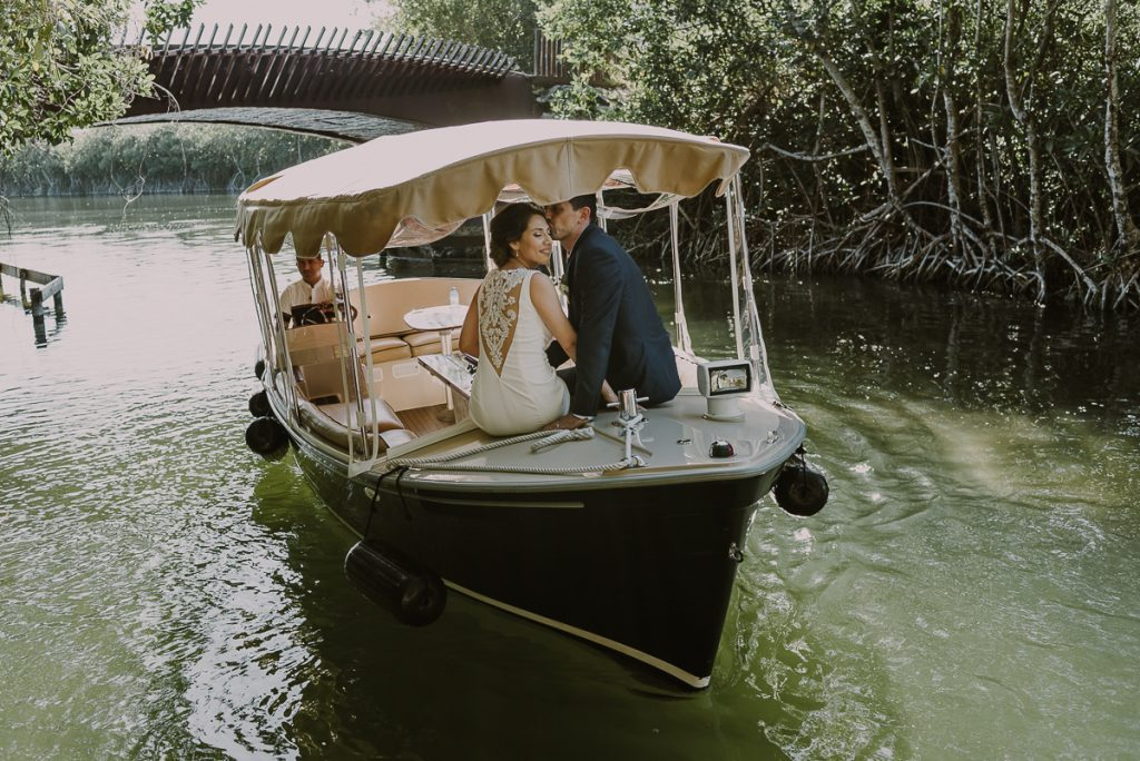 Bride and groom portraits on boat at Banyan Tree Mayakoba, Mexico. Caro Navarro Photography