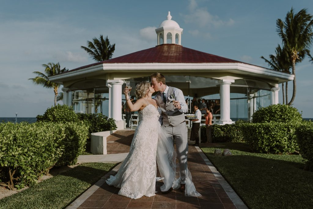 Newlyweds exiting the wedding chapel at Moon Palace Nizuc, Cancun. Caro Navarro Photography