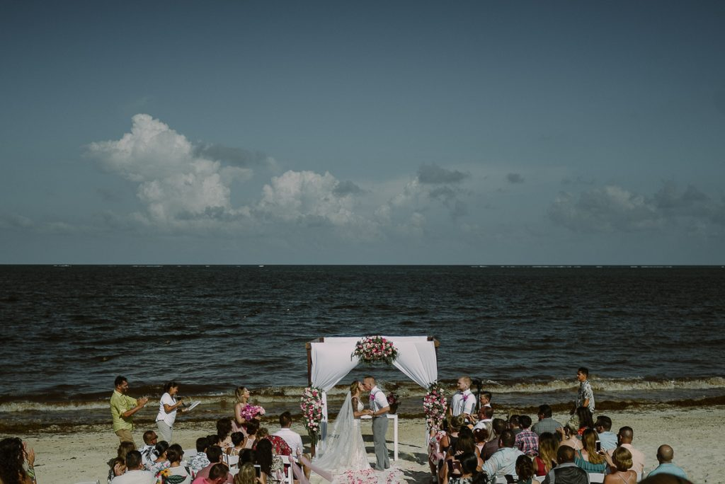 You may kiss the bride. Now Sapphire Riviera Cancun Wedding by Caro Navarro Photography