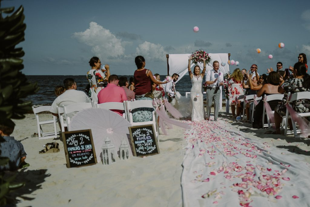 Bride and groom exit with beach balls toss. Now Sapphire Wedding by Caro Navarro Photography
