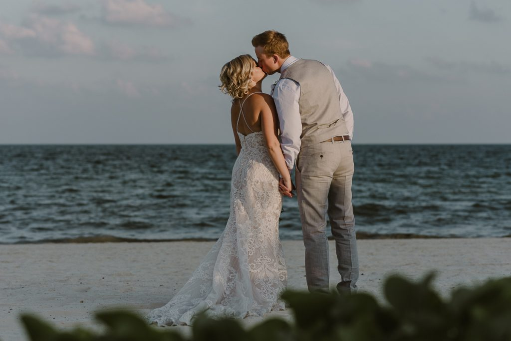 Bride and groom beach portraits at Moon Palace Nizuc. Caro Navarro Photography