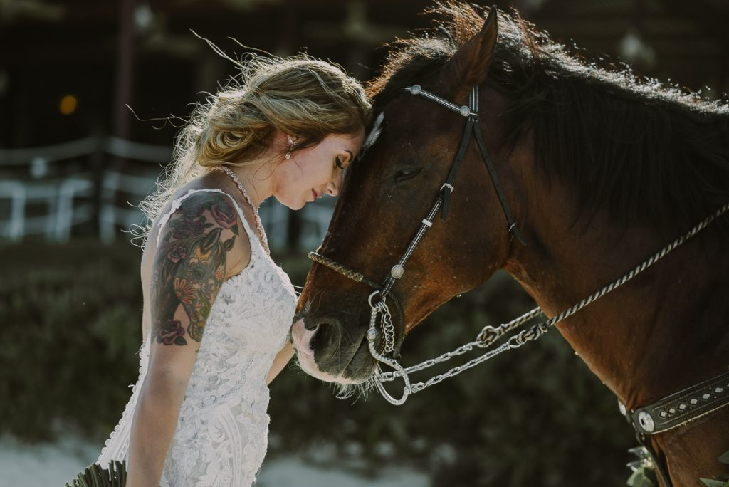Boho beach bride and horse portraits at Now Sapphire Riviera Cancun, Mexico. Caro Navarro Photography