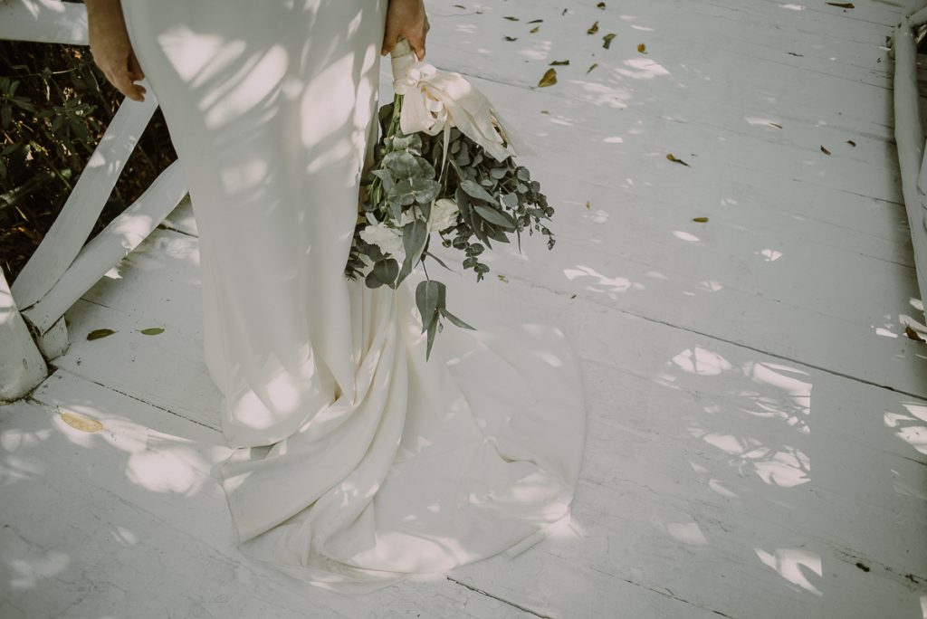 Wedding dress and bouquet detail by Caro Navarro Photography at Banyan Tree Mayakoba