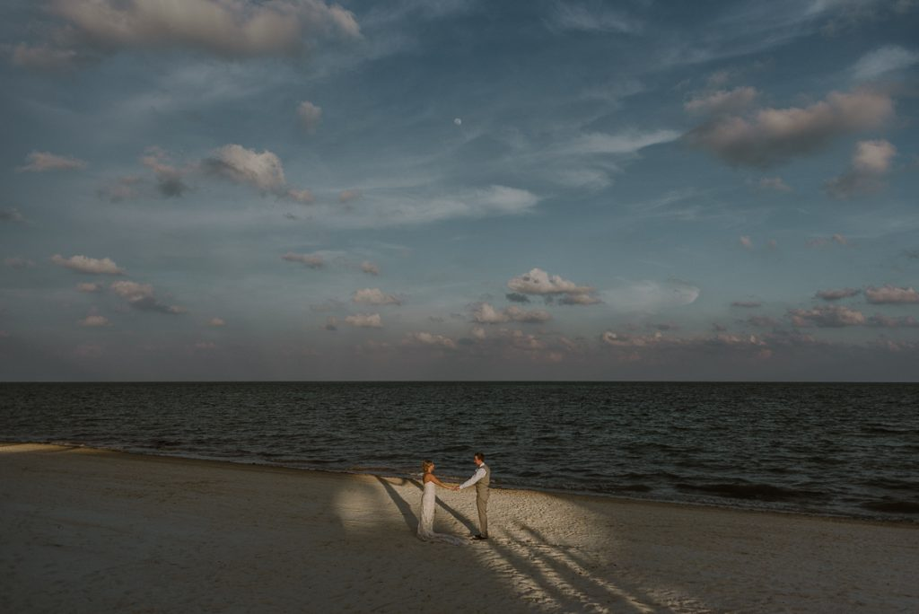 Bride and groom beach portraits at Moon Palace Nizuc. Caro Navarro Cancun Wedding Photography