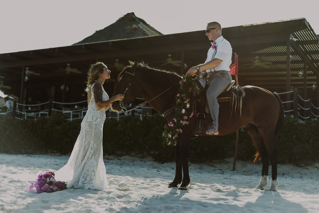 Beach bride and groom portraits on horse. Now Sapphire Riviera Cancun Wedding by Caro Navarro Photography