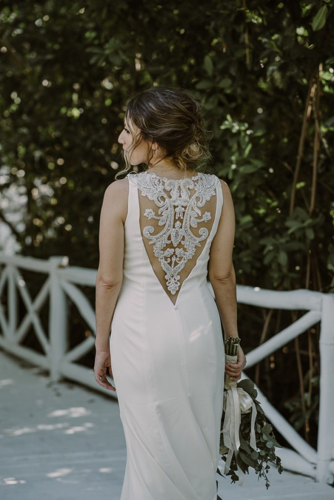 Backless lace wedding dress at Banyan Tree Mayakoba Wedding in Mexico. Caro Navarro Photography
