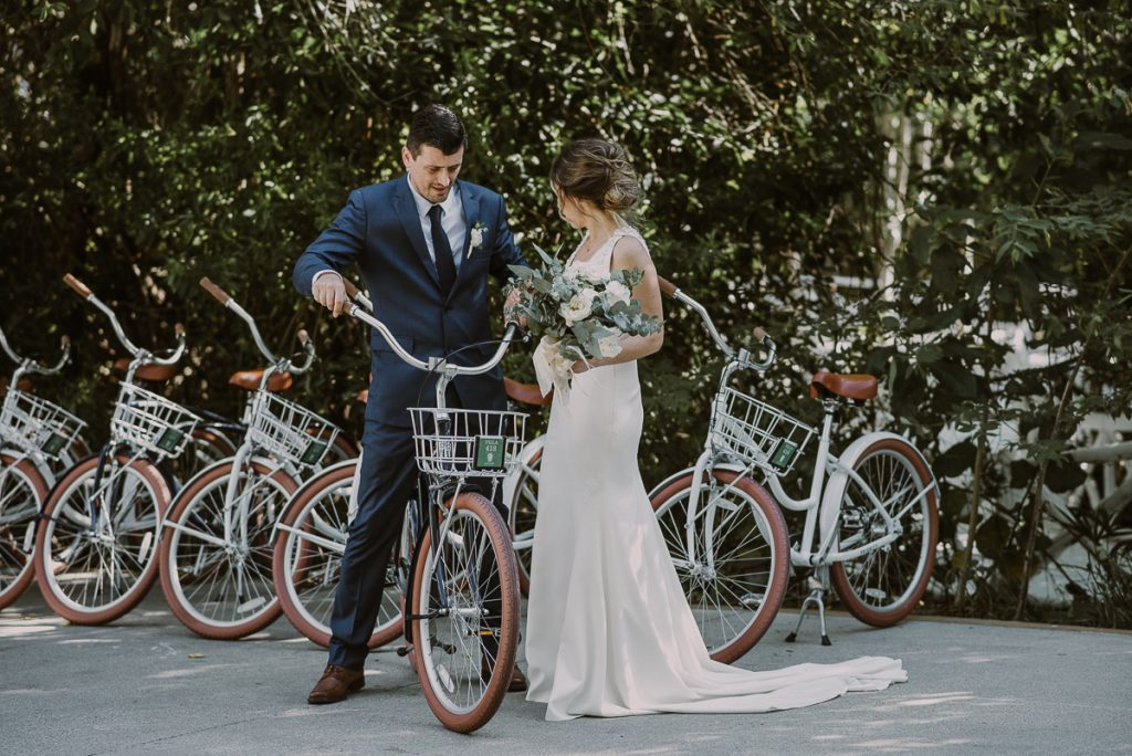 Bride and groom portraits with bikes at Banyan Tree Mayakoba, Mexico by Caro Navarro Photography