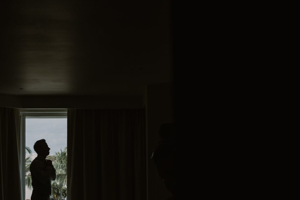 Groom silhouette in room at Moon Palace Nizuc Cancun. Caro Navarro Photography