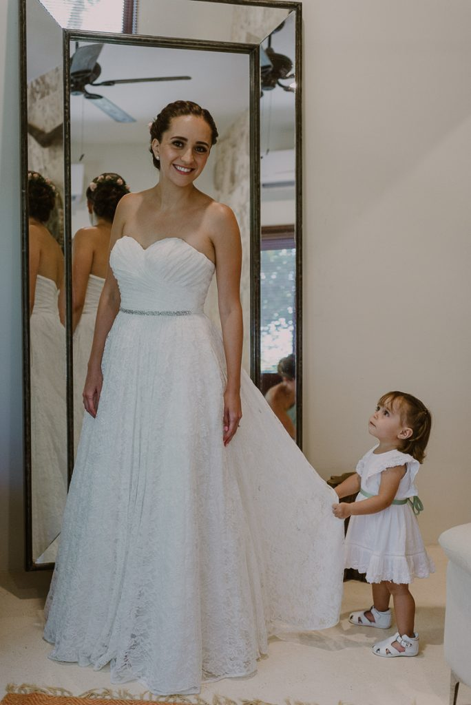 Destination bride and cute flower girl at Jardin del Mar, Riviera Maya Wedding. Caro Navarro Photography