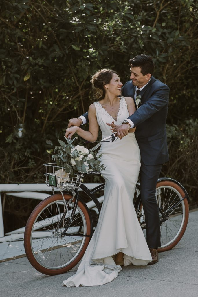 Bride and groom bike portraits at Banyan Tree Mayakoba, Mexico by Caro Navarro Photography