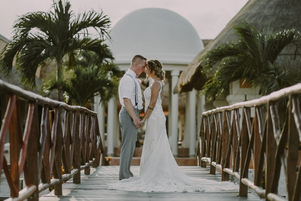 Bride and groom portraits on bridge at Now Sapphire Riviera Cancun, Mexico. Caro Navarro Photography