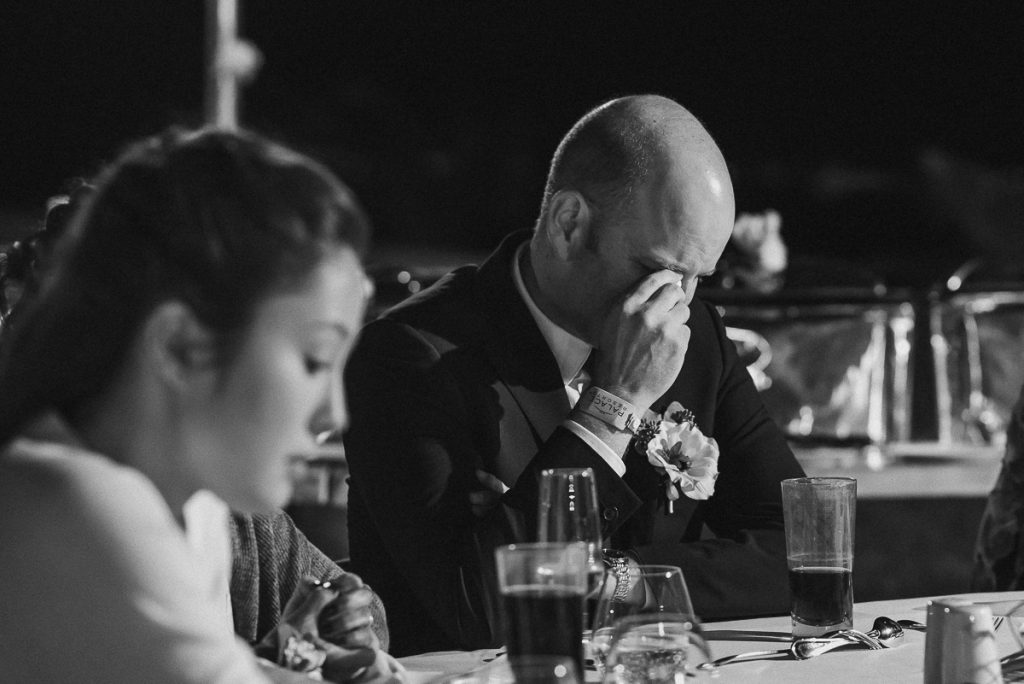 Emotional wedding guests at Moon Palace Nizuc reception. Caro Navarro Photography