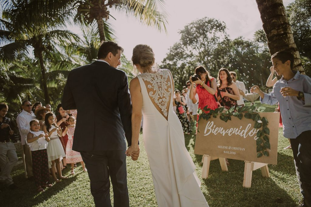Bride and groom entrance. Playa del Carmen Garden Wedding by Caro Navarro Photography