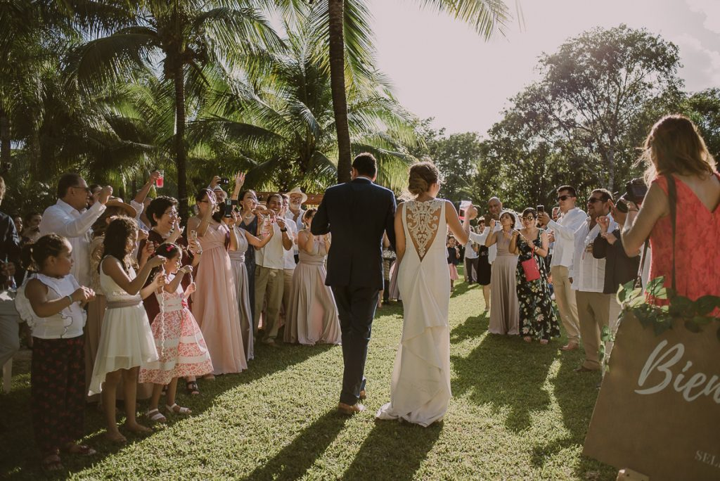 Bride and groom entrance at Playa del Carmen garden wedding by Caro Navarro Photography