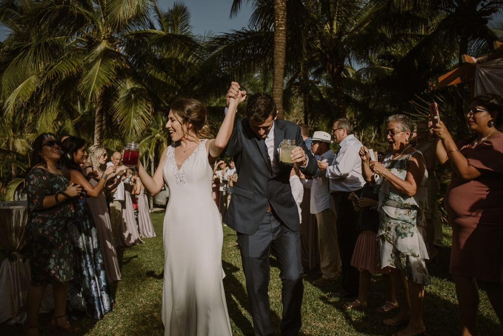 Bride and groom celebrate at Playa del Carmen garden wedding by Caro Navarro Photography