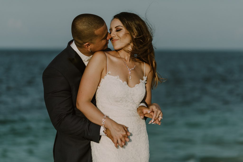 Bride and groom beach portraits. Riu Caribe Cancun destination wedding by Caro Navarro Photography