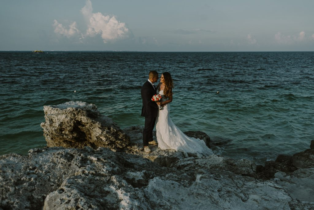 Bride and groom cliff portraits. Riu Caribe destination wedding by Caro Navarro Photography