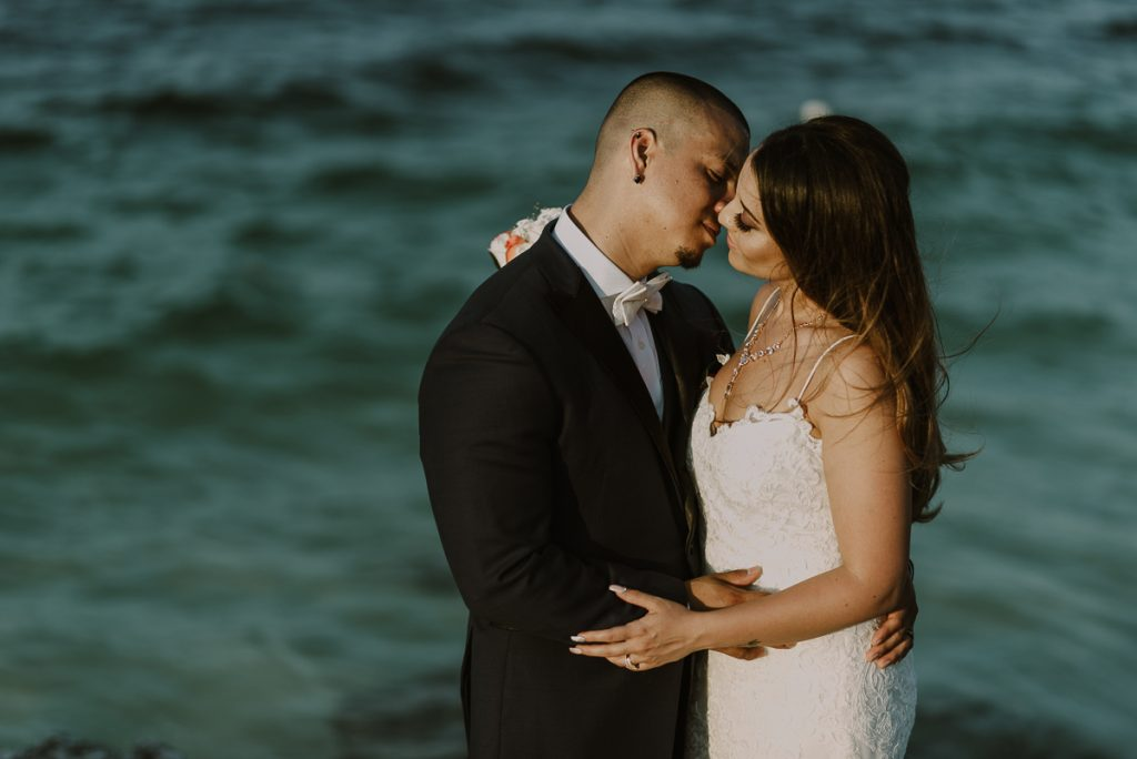 Bride and groom beach portraits. Riu Caribe wedding by Caro Navarro Photography