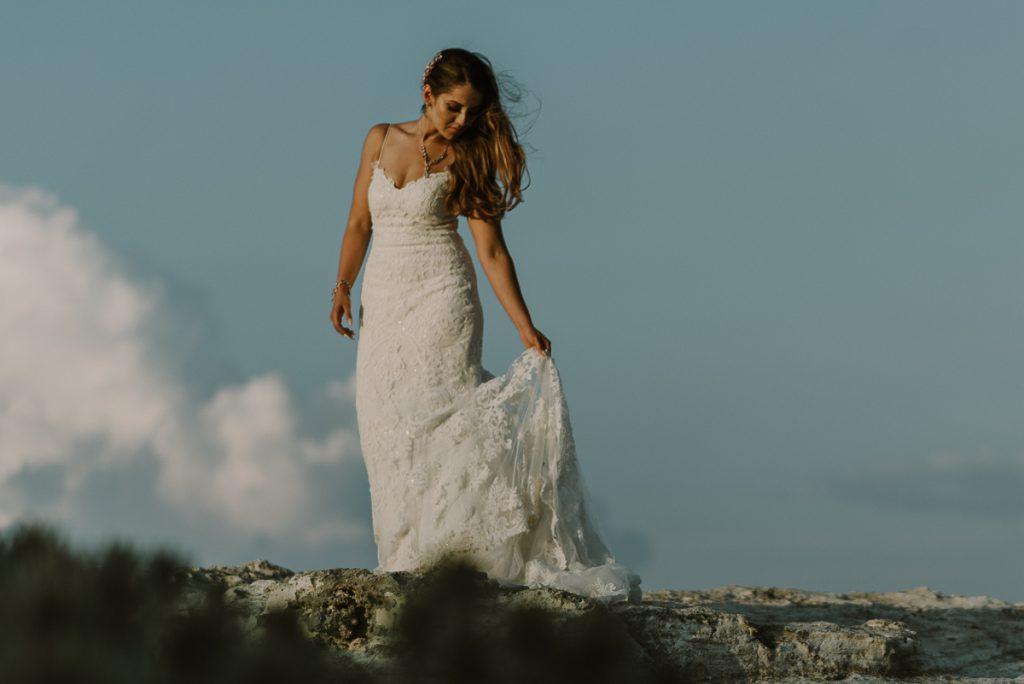Beach bride portraits. Riu Caribe Cancun destination wedding by Caro Navarro Photography