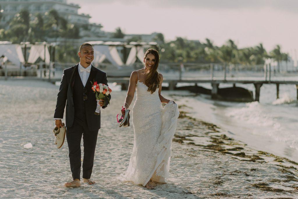 Bride and groom beach portraits. Riu Caribe Cancun destination wedding by Caro Navarro Photography