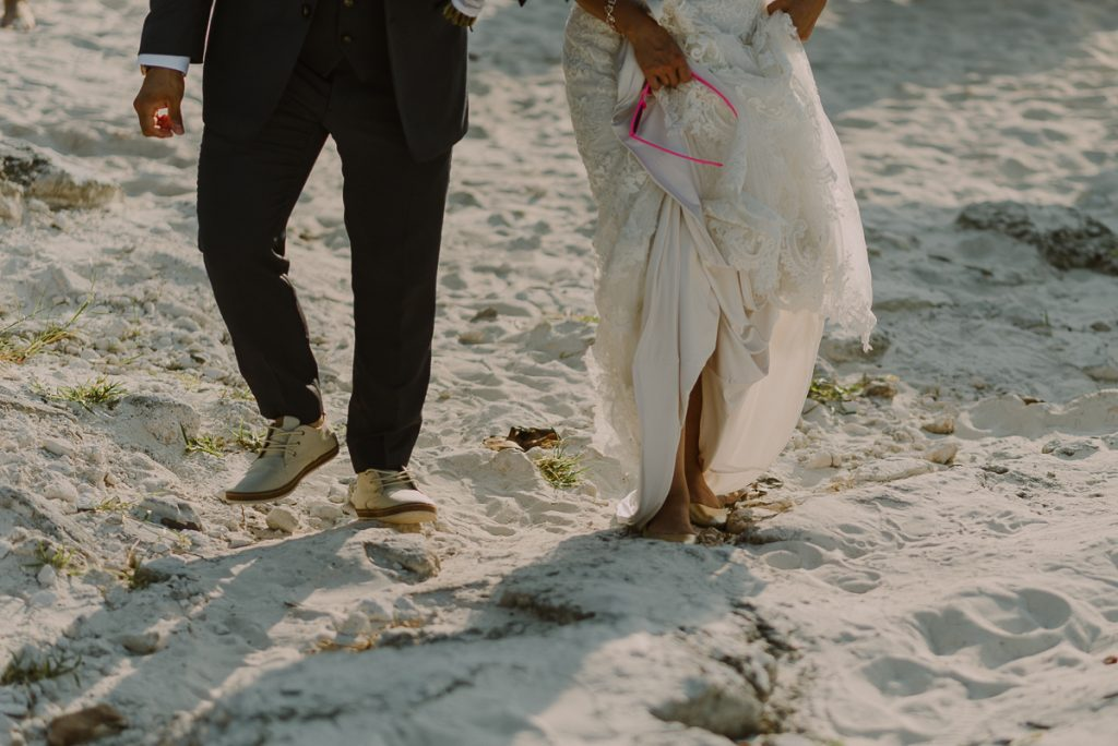 Bride and groom beach portraits closeup. Riu Caribe Cancun destination wedding by Caro Navarro Photography