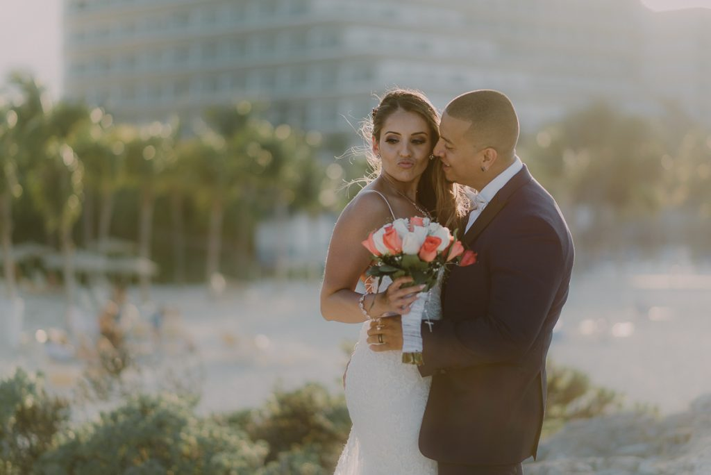 Bride and groom sunset portraits. Riu Caribe Cancun destination wedding by Caro Navarro Photography