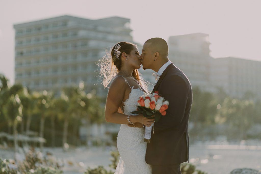 Destination Bride and groom beach portraits. Riu Caribe Cancun wedding by Caro Navarro Photography