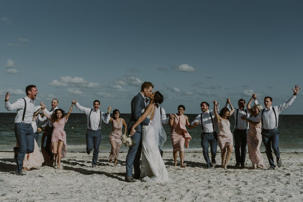Beach bride and groom and bridal party photo. Royalton Riviera Cancun Wedding by Caro Navarro Photography