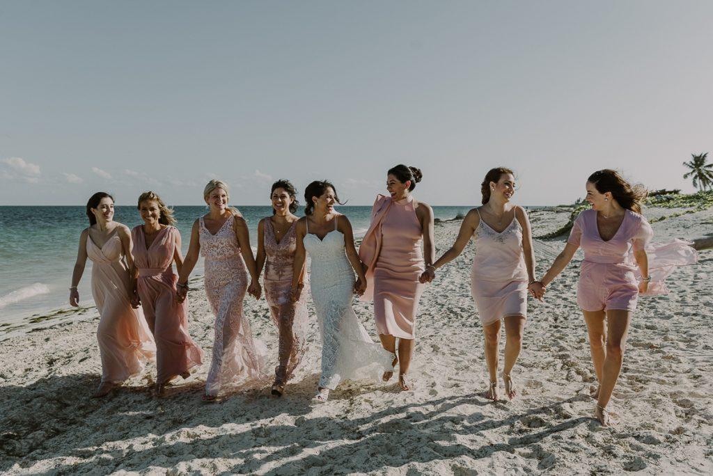 Pink bridesmaids and beach bride at Royalton Riviera Cancun. Caro Navarro Photography