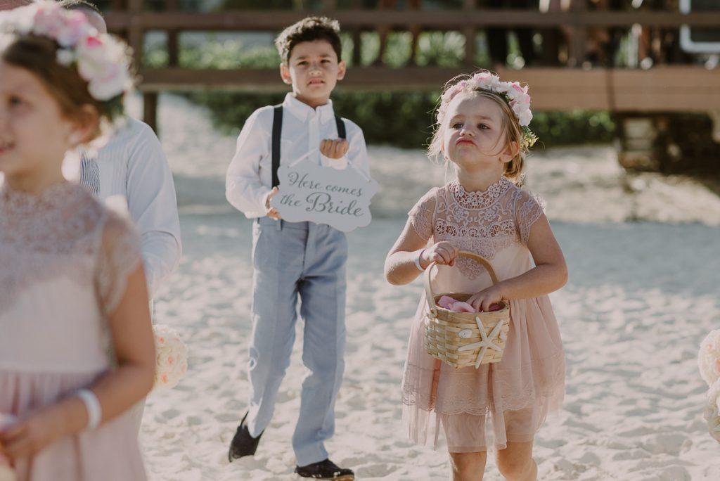 Pink flower girl. Royalton Riviera Cancun Beach Wedding. Caro Navarro Photography