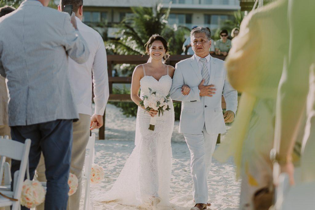 Emotional bride entrance. Royalton Riviera Cancun beach wedding by Caro Navarro Photography