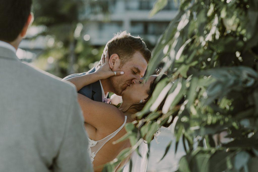 You may kiss the bride. Royalton Riviera Cancun beach wedding by Caro Navarro Photography