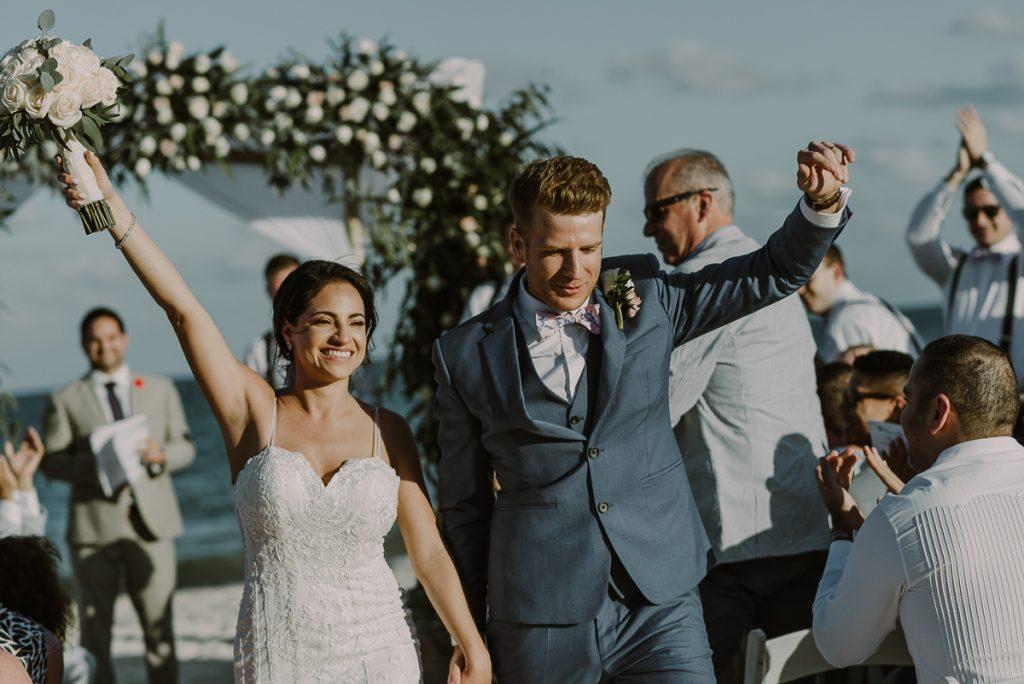 Newlyweds exit. Royalton Riviera Cancun destination wedding by Caro Navarro Photography
