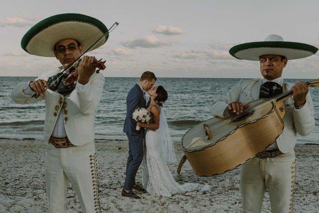 Beach bride and groom with mariachis at Royalton Riviera Cancun wedding. Caro Navarro Photography