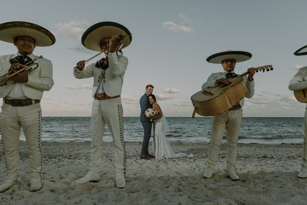 Beach bride and groom portraits with mariachi at Royalton Riviera Cancun. Caro Navarro Photography