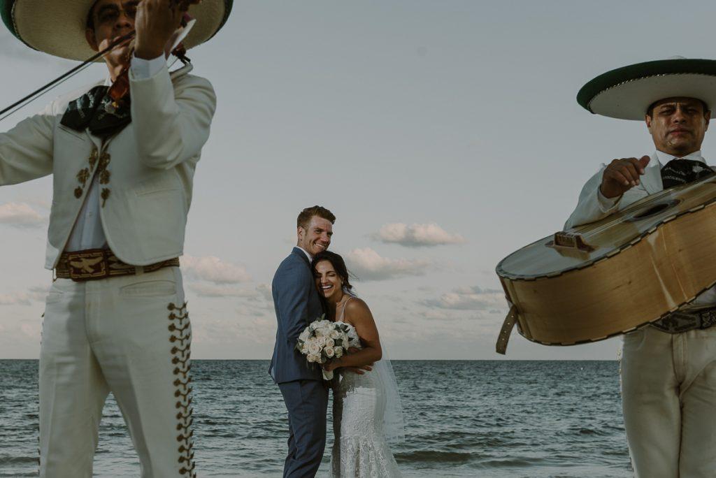 Newlyweds with mariachi. Royalton Riviera Cancun destination wedding by Caro Navarro Photography