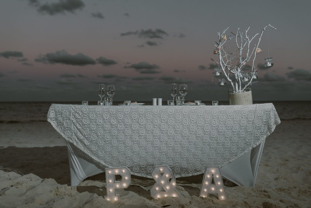 Sweetheart table with lighted letters. Royalton Riviera Cancun Wedding by Caro Navarro Photography