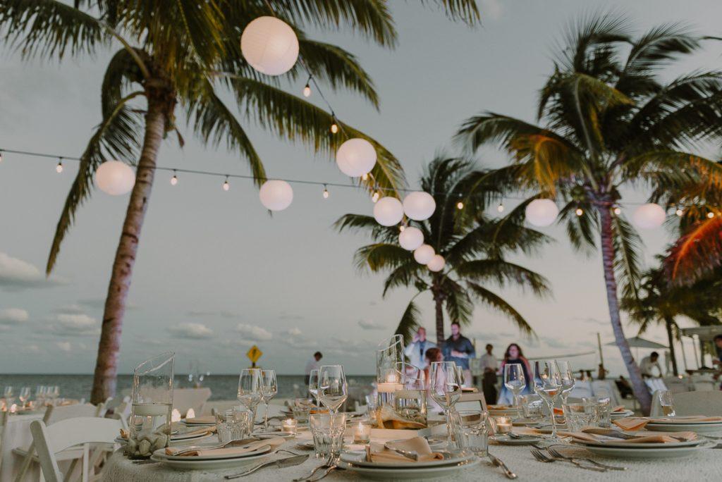Beach wedding reception with bistro lights. Royalton Riviera Cancun, Mexico. Caro Navarro Photography